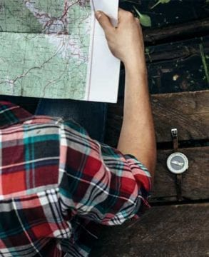 Man looking on map before hiking in the Smoky Mountains