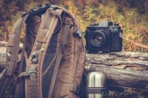 backpack with camera and canteen
